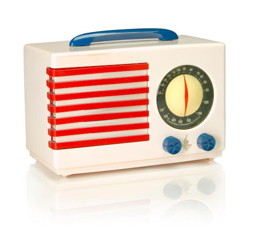 An Emerson 400 Patriot 1940 White case with blue handle and knobs, red and white grille, with Emerson decal. height 7 1/4in (18.5cm); length 10 7/8in (27.6cm); depth 5 3/8in (13.6cm)