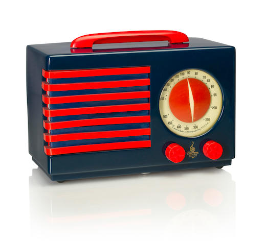 An Emerson 400 Patriot 1940 Blue case with red handle and knobs, red and blue grille, with Emerson decal. height 7 1/4in (18.5cm); length 10 7/8in (27.6cm); depth 5 3/8in (13.6cm)