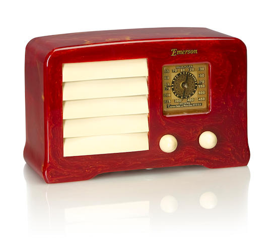 An Emerson AX235 Little Miracle 1938 Marbleized raspberry case with white knobs and louvered grille, with Emerson decal. height 5 1/4in (13.4cm); length 8 7/8in (22.5cm); depth 3 3/4in (9.5cm)