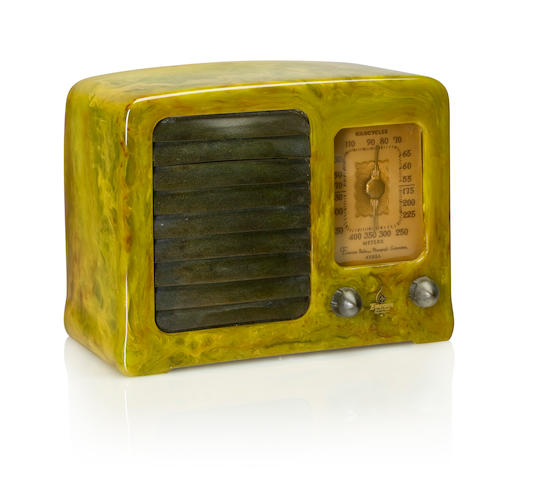 An Emerson BN258 1937 Marbleized green case with green knobs and louvered grille, with Emerson decal. height 7 1/4in (18.4cm); length 9 3/8in (23.6cm); depth 5in (12.6cm)
