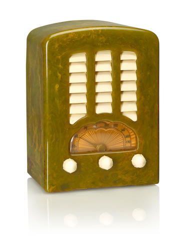 An Emerson BT245 Cathedral 1938 Marbleized green case with white knobs and louvered grille, with Emerson decal. height 10in (25.5cm); width 7 1/4in (18.5cm); depth 5in (12.8cm)