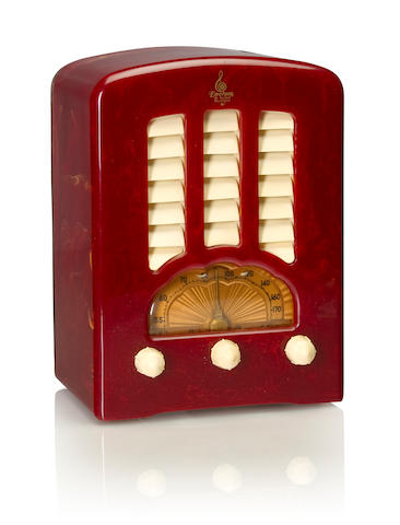 An Emerson BT245 Cathedral 1938 Marbleized raspberry case with white knobs and louvered grille, with Emerson decal. height 10in (25.5cm); width 7 1/4in (18.5cm); depth 5in (12.8cm)