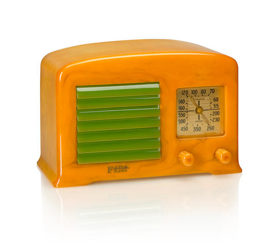 A Fada 53X 1938 Yellow case with matching knobs and green louvered grille, Fada Radio decal. height 5 1/2in (14cm); length 8 1/2in (22cm); depth 5 1/2in (14cm)