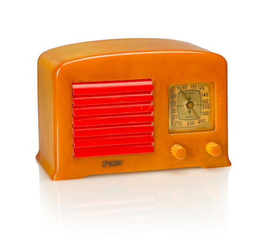 A Fada 53X 1938 Yellow case with matching knobs and red louvered grille, Fada Radio decal. height 5 1/2in (14cm); length 8 1/2in (22cm); depth 5 1/2in (14cm)