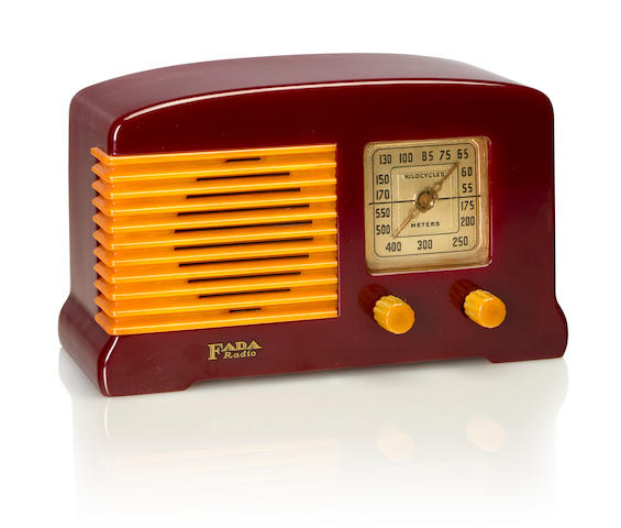 A Fada 52 1938 Maroon case with yellow knobs and grille, with Fada decal. height 5 1/2in (14cm); length 9in (22.8cm); depth 5 1/2in (14cm)