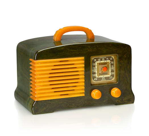 A Fada L-56 1939 Marbleized blue case with yellow knobs and handle and grille, with Fada decal. height 5 1/2in (14cm); length 9in (22.8cm); depth 5 1/2in (14cm)