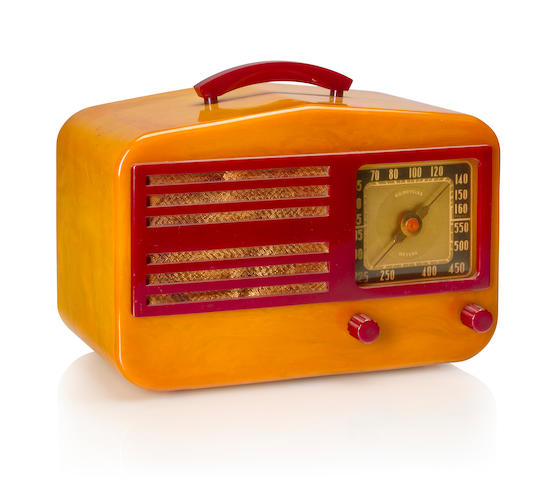 A Garod 1450 Peak-Top 1940 Yellow case with red knobs, handle and faceplate. height 6 5/8in (14cm); length 11in (28cm); depth 5 1/2in (14cm)