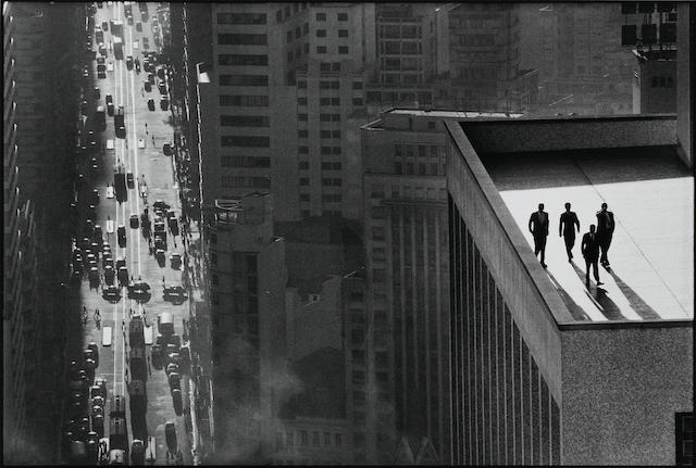 Rene Burri, Sao Paulo, Brazil [men on rooftop], 1960, Gelatin silver print, 11 x 14 inches, Signed, titled & dated in pencil on verso ///