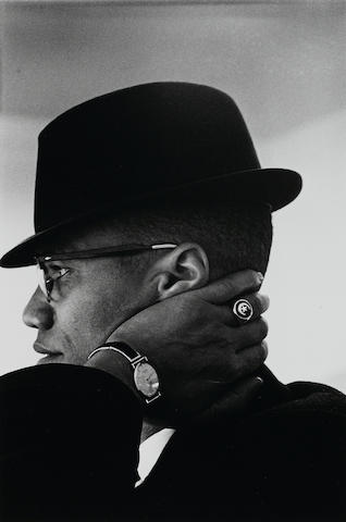 Eve Arnold, Portrait of Malcolm X, Chicago, 1960, Gelatin silver print, 16 x 12 inches, Signed on verso in pencil