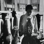 Eve Arnold, Self Portrait in a Distorting Mirror, c. 1950s, Gelatin silver print, 14 x 11 inches; Signed, titled & dated in pencil on verso