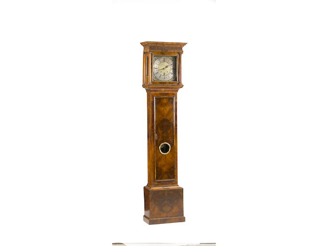 A Queen Anne walnut tall case clock first quarter 18th century