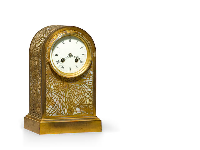 A Tiffany Studios Favrile glass and gilt-bronze Pine Needle arched-top clock 1899-1918