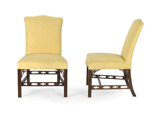 A set of six George III style upholstered mahogany dining chairs<BR /> 20th century