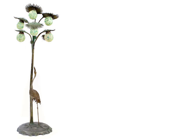 A patinated bronze and mottled glass Crane and Palm floor lamp