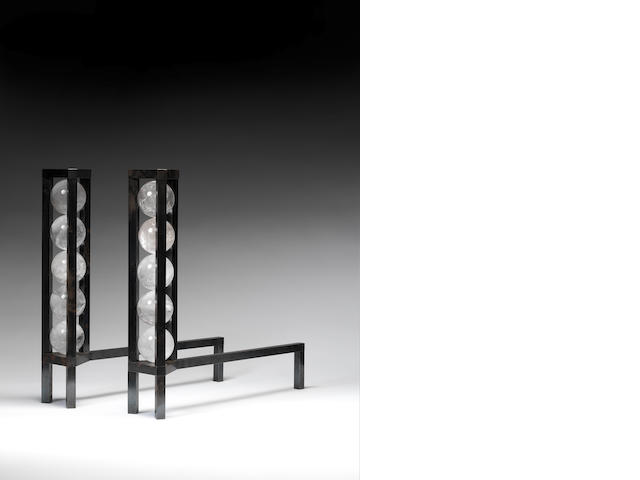 A pair of steel andirons each with column of five rock crystal spheres Paul Belvoir, English 2011