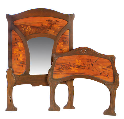 An Art Nouveau marquetry single headboard and footboard