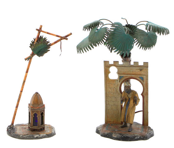 A group of two Austrian cold painted metal figural lamps