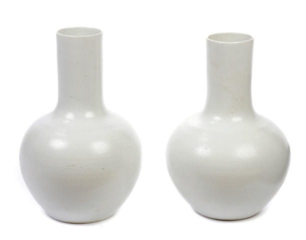 A large pair of Chinese white glazed vases