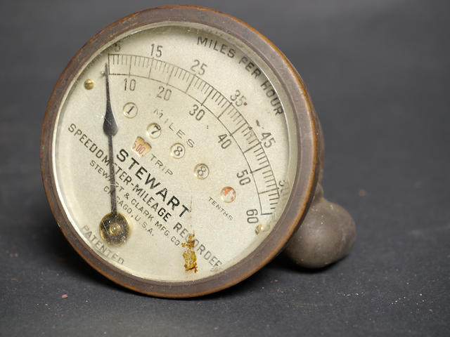 A large Stewart 60mph speedometer/mileage recorder.