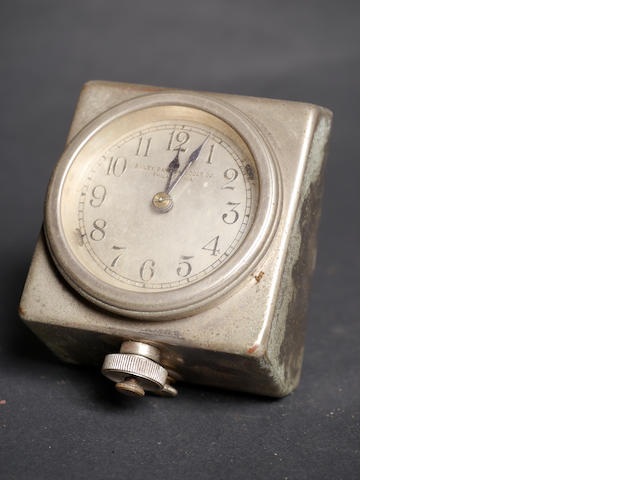 A good, 8-day nickel plated car clock by Bailey Banks & Biddle,