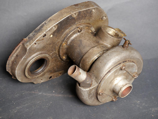 A competition front timing cover for a Flathead Ford V-8,