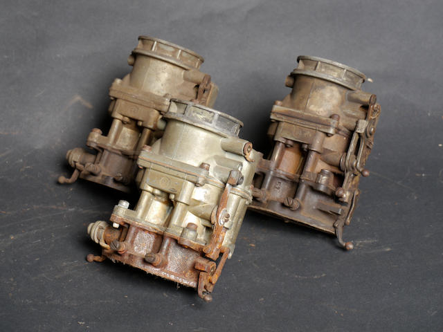 A set of three Ford 59/Stromberg 94 carburetors,