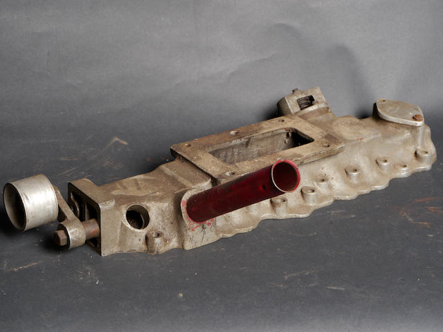 "An original manifold for an Intermecchanica ""SCoT"" supercharger for a Ford flathead V-8,"