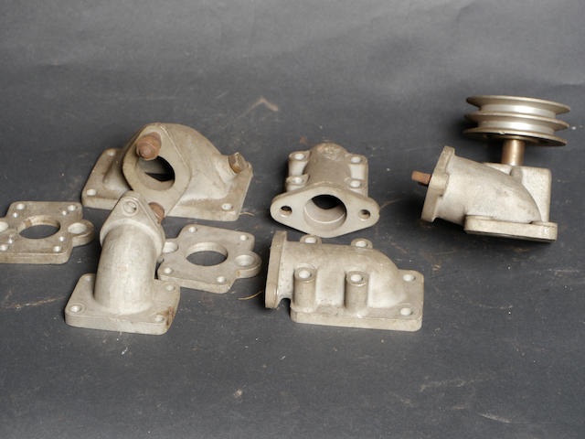 An assortment of S.Co.T Italmeccanica manifolds and adapters,