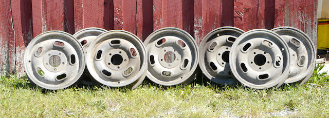 "A set of seven Halibrand magnesium 16"" racing wheels,"