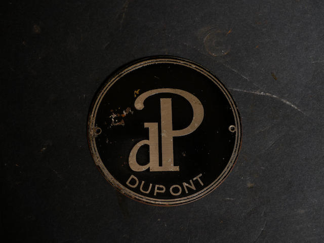 A large duPont wheel emblem.