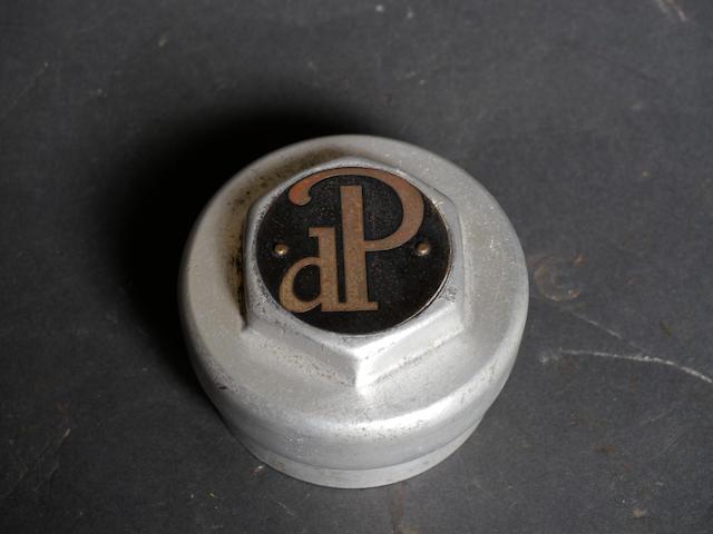 A hubcap with a duPont emblem.