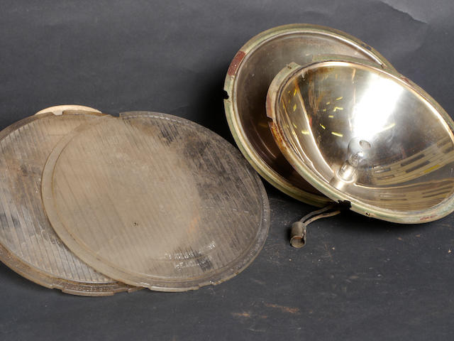 A pair of headlamp reflectors and lenses for a duPont Model G.