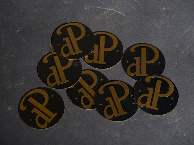 A quantity of duPont wheel emblems.