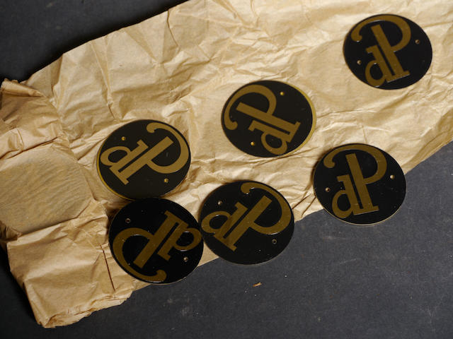 A quantity of duPont wheel emblems,