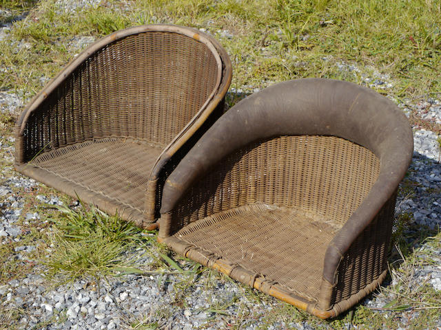 A pair of wicker bucket seats,