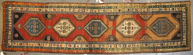 A Northwest Persian runner  size approximately 3ft. 9in. x 13ft.