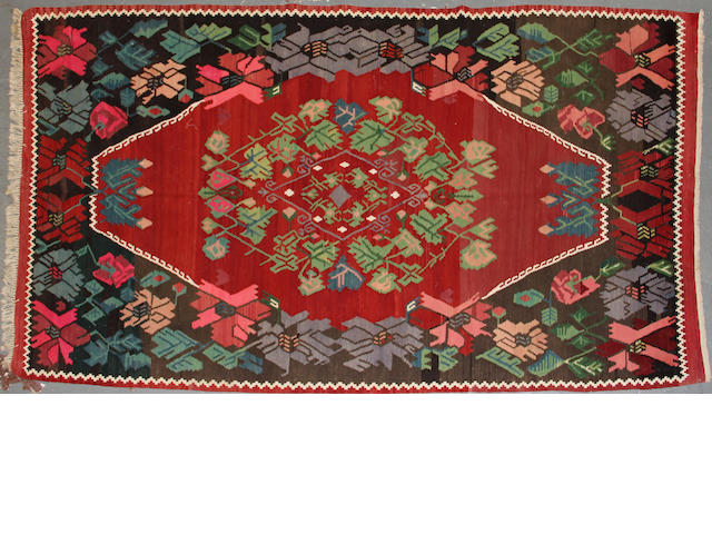 A Besarabian kilim size approximately 4ft. 8in. x 8ft. 3in.