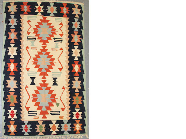 A Kilim size approximately 5ft. 7in. x 9ft. 4in.