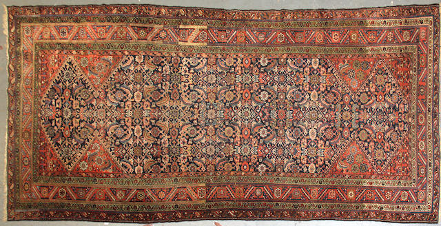 A Kurdish long carpet size approximately 5ft. 4in. x 11ft. 3in.