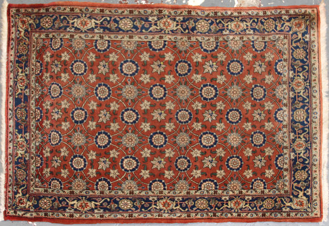 A Sarouk rug  size approximately 3ft. 7in. x 5ft. 3in.