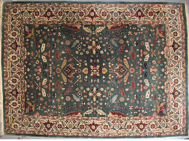 An Indian carpet  size approximately 9ft. x 12ft. 7in.