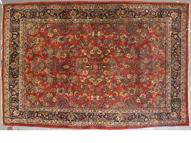 A Sarouk rug size approximately 6ft. 3in. x 9ft.