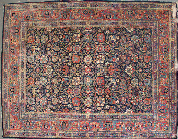 A Tabriz carpet  size approximately 9ft. 2in. x 12ft.