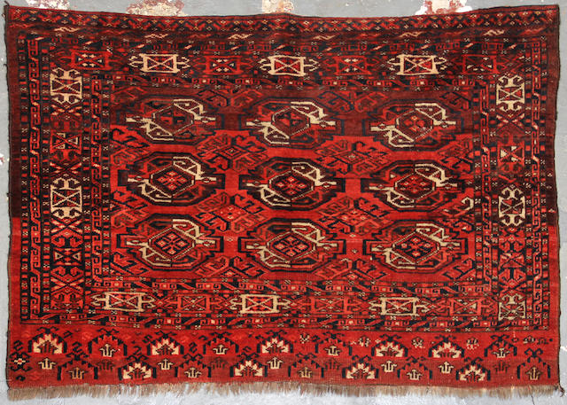A Turkoman rug  size approximately 2ft. 9in. x 4ft.