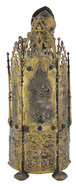 A German 13 standard silvered gilt and paste jeweled figure of a seated bishop Hanau  late 19th century
