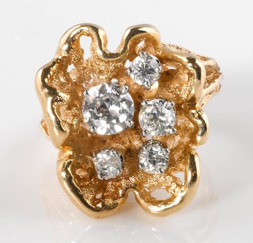 A diamond and 14k gold freeform ring