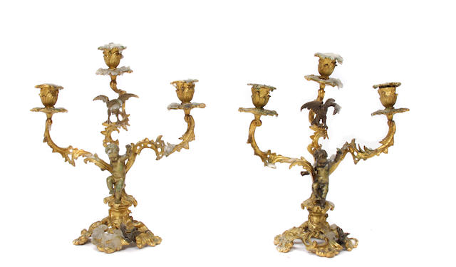A pair of Louis XV style gilt bronze three light candelabra
