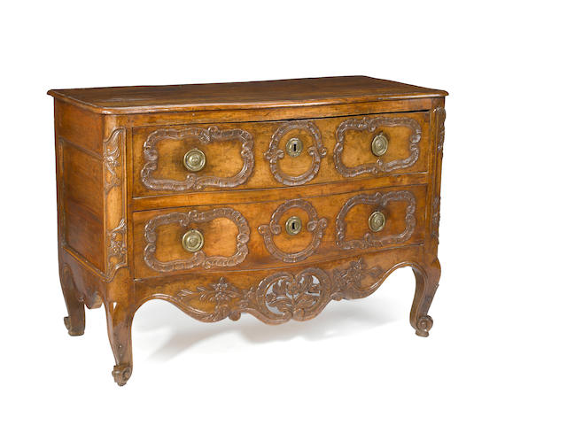 A Louis XV walnut commode en arbalette <BR />mid 18th century, probably Lyons