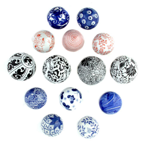 An assembled group of ceramic carpet balls