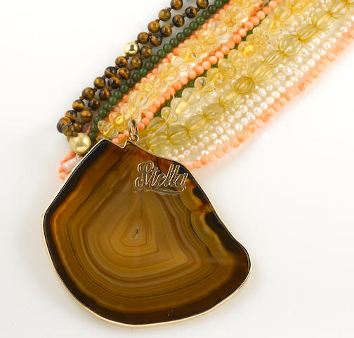A collection of hardstone, freshwater cultured pearl, citrine, 14k gold, and yellow metal jewelry